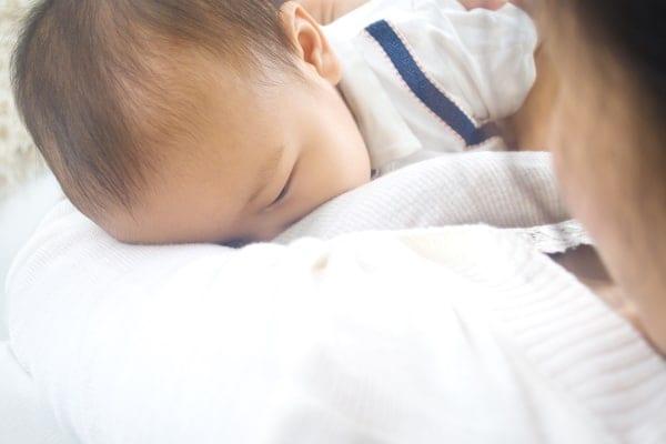 Do nipple piercings affect breastfeeding. Mother breastfeeding her baby boy