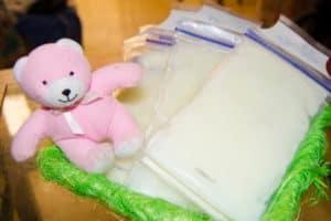 frozen breast milk in storage bags in the basket