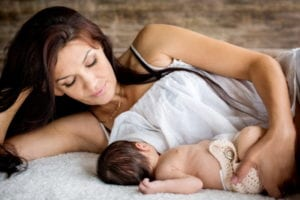 Mother feeding her newborn with breast